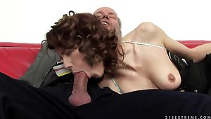A cute redhead fingers an old man's arse hole