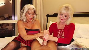 Mature sluts with fake tits pleasuring one lucky guy together