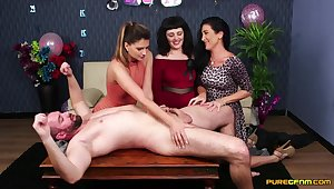 Amateur guy lays on the table getting blowjobs by three cuties