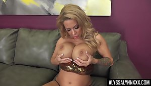Attractive and seductive lady with big boobies Alyssa Lynn teases herself