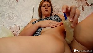 Redhead cougar uses a sex toy upstairs herself